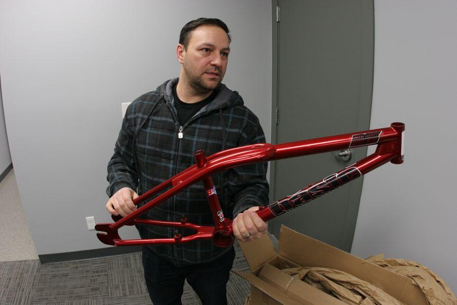 Cecil Milligan holding a Basic Bikes Big City Bastard BMX Frame