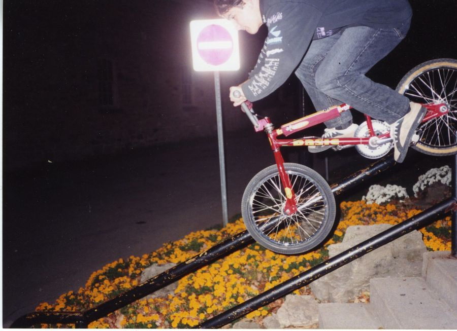 Dave Thom grinding a handrail on a Basic Bikes Streetfighter Frame